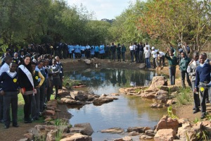 Stream it Forward: The new wetland fixture of the Walter Sisulu Environmental Centre is surrounded by schoolchildren from Mamelodi high schools and Miss Earth South Africa 2012 Tamerine Jardine.