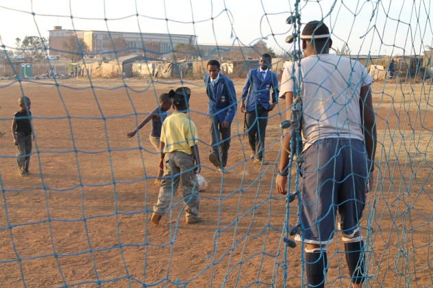 Young and Ballin': A few of the 245 children living at Woodlane Village in Pretoria east play soccer on a dusty field. Their parents are mainly South African and Zimbabwean seeking economic refuge. The makeshift settlement was recently established and is administered by Tswelopele, a charity organisation that assists destitute communities achieve independence.