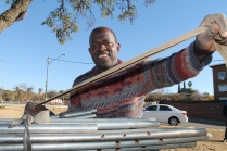 Mudzvamuse packs up his stock to begin the one kilometre journey to his rented house on Nikkel Street.